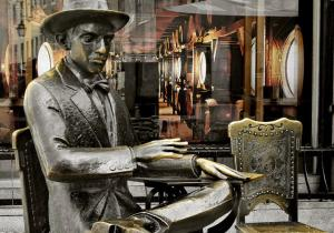 shoo-go-away-says-the-statue-of-pessoa-in-chiado