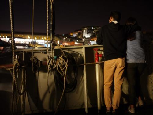 Couple looking out over the city from Lisbon Boat Party